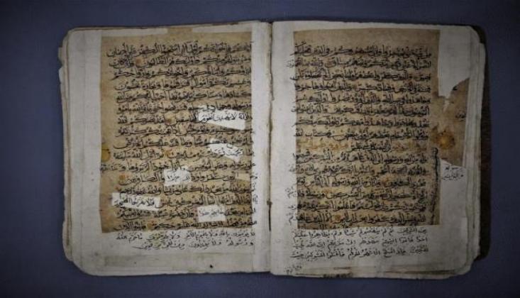 Hz. Abbas (a.s) Türbesi'nde Eski Kur'an-ı Kerim Nüshası Onarıldı